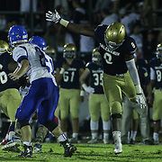 Salesianum linebacker Joshua Patrick (8) attempts to take down Middletown quarter back Vincent Delpercio (2) in the second half Friday, Oct. 09, 2015 at Bernard Stadium in Wilmington, DE.