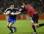 24 May 2003, Eden Park Auckland, Rugby Union, Xtra Super 12 Final, Auckland Blues vs Canterbury Crusaders.<br />Blue's David Gibson fends off Crudader's captain Reuben Thorne during the Blue's  21-17  win over the crusaders on Saturday night.<br />Pic: Marty Melville/Photosport