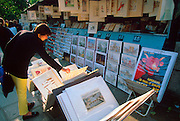 FRANCE, PARIS, LEFT BANK booksellers on Quai de Montebello along the River Seine; books, posters, etc. are sold from outdoor boxes