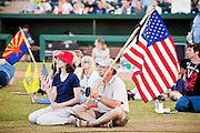 "May 29 - TEMPE, AZ: A man and his daughter with the American and Arizona flags at an anti-immigration rally in Tempe, AZ, Saturday. About 3,000 people attended a ""Buy Cott Arizona"" rally at Tempe Diablo Stadium in Tempe, AZ Saturday night. The rally was organized by members of the Arizona Tea Party movement to show support for Arizona law SB1070. The ""Buy Cott"" is a reaction to the economic boycott planned by opponents of SB1070. SB1070 makes it an Arizona state crime to be in the US illegally and requires that immigrants carry papers with them at all times and present to law enforcement when asked to. Critics of the law say it will lead to racial profiling, harassment of Hispanics and usurps the federal role in immigration enforcement. Supporters of the law say it merely brings Arizona law into line with existing federal laws.  Photo by Jack Kurtz"