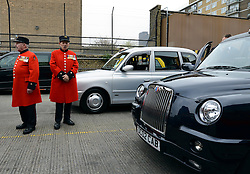 © Licensed to London News Pictures. 02/05/2012. London, UK. Two Chelsea Pensioners wait near the cabs.  London Mayor, Boris Johnson is joined by comedian Al Murray to wave off an army of WWII veterans who are embarking on an iconic trip to the Netherlands, via a convoy of black cabs. The London Taxi Benevolent Association for the War Disabled has organised a trip for 160 WWII veterans to travel to Holland in 80 London Black Cabs. The veterans, mostly aged between 85 and 94, will start their journey from London today 2nd May 2012 and will be visiting sites of importance from WWII and taking part in Dutch Liberation Day celebrations as guests of honour of the Dutch Royal Family.. Photo credit : Stephen Simpson/LNP