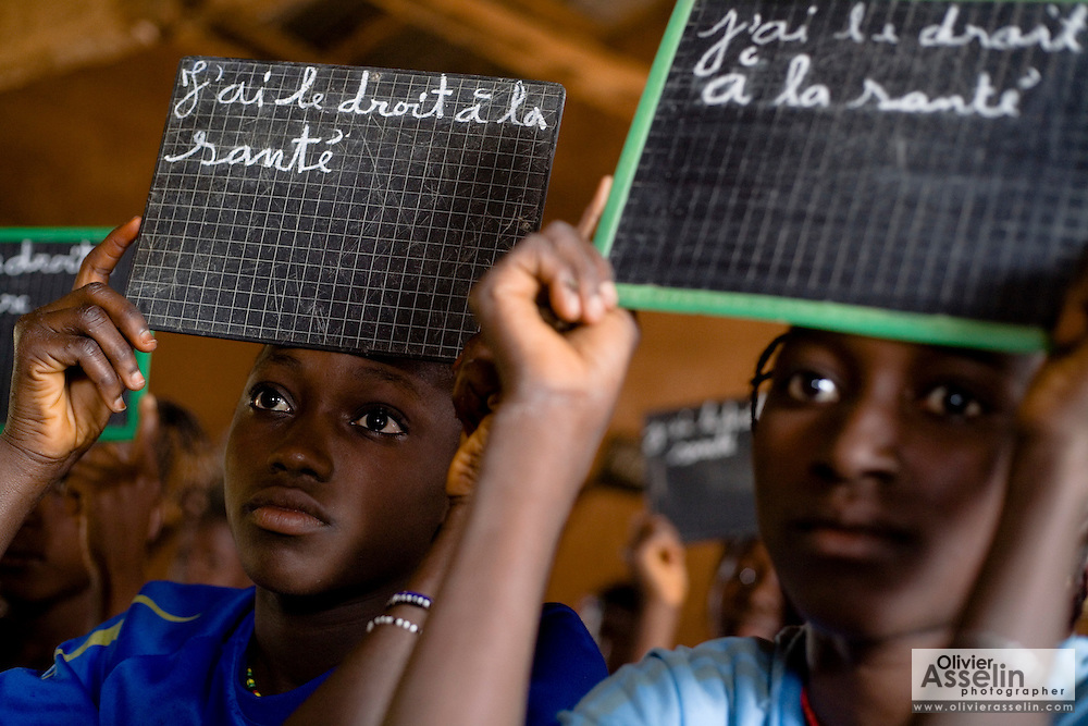 Children hold chalk boards on which are written basic children's rights at the Kabiline I Primary school in the village of Kabiline, Senegal on Wednesday June 13, 2007...
