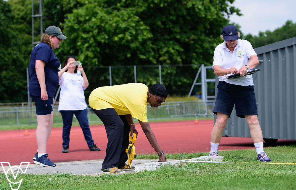 Metro Blind Sport's 2017 Athletics Open held at Mile End Stadium.  Shot put.  Volunteers and officials.<br /> <br /> Picture: Chris Vaughan Photography for Metro Blind Sport<br /> Date: June 17, 2017