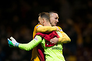 3rd November 2018, Fir Park, Motherwell, Scotland; Ladbrokes Premiership football, Motherwell versus Dundee; Tom Aldred and Trevor Carson of Motherwell celebrate at the end of the match