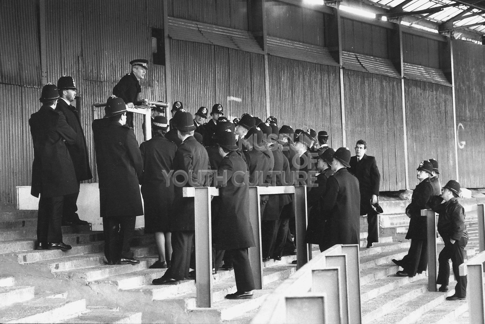 Group of policeman having a meeting on the stand of a football stadium