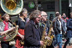 London, May 1st 2016. A brass band leads the way as members of various trade unions and workers' groups march through London on May Day, International Workers' Day. &copy;Paul Davey<br /> FOR LICENCING CONTACT: Paul Davey +44 (0) 7966 016 296 paul@pauldaveycreative.co.uk