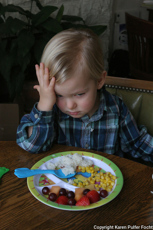 A toddler is introduced to healthy foods.