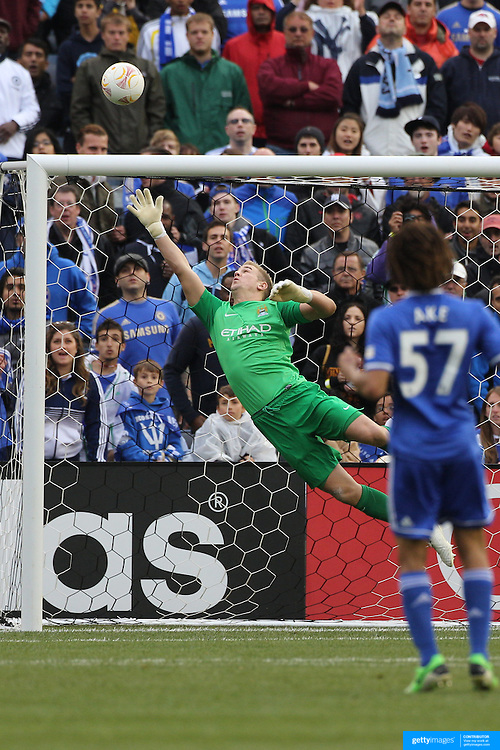 Joe Hart, Manchester City is beaten by a shot that hits the bar in action during the Manchester City V Chelsea friendly exhibition match at Yankee Stadium, The Bronx, New York. Manchester City won the match 5-3. New York. USA. 25th May 2012. Photo Tim Clayton