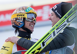 04.01.2015, Bergisel Schanze, Innsbruck, AUT, FIS Ski Sprung Weltcup, 63. Vierschanzentournee, Innsbruck, 2. Wertungsdurchgang, im Bild v.l.: Noriaki Kasai (JPN) und Simon Ammann (SUI) // f.l.: Noriaki Kasai of Japan and Simon Ammann of Switzerland reacts after his second competition jump for the 63rd Four Hills Tournament of FIS Ski Jumping World Cup at the Bergisel Schanze in Innsbruck, Austria on 2015/01/04. EXPA Pictures © 2015, PhotoCredit: EXPA/ JFK