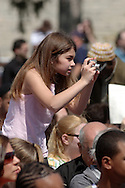 Middletown - A young girl takes a photograph with a digital camera during the 58th commencement at Orange County Community College on May 17, 2008.