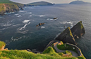 Dunquin Pier is located in Co. Kerry, Ireland, along a coastal stretch framed by huge cliffs.  A narrow road winds its way down to the pier.