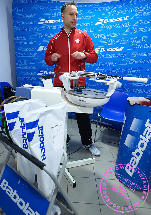 Stringer Piotr Chomicki prepares tennis rocket during first day the Davies Cup / Group I Europe / Africa 1st round tennis match between Poland and Lithuania at Orlen Arena on March 6, 2015 in Plock, Poland<br /> Poland, Plock, March 6, 2015<br /> <br /> Picture also available in RAW (NEF) or TIFF format on special request.<br /> <br /> For editorial use only. Any commercial or promotional use requires permission.<br /> <br /> Mandatory credit:<br /> Photo by &copy; Adam Nurkiewicz / Mediasport