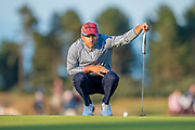 Benjamin Hebert (FRA) surveys the line of his putt on the 18th green during the final round of the Aberdeen Standard Investments Scottish Open at The Renaissance Club, North Berwick, Scotland on 14 July 2019.