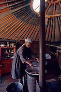 Mongolia. childrens, sheep and  icy rain  -A ger camp after a hailstorm.. Life comes back to normal after the storm.  The men go out to check on the animals.  In the foreground is a wooden wheel of days gone by, (Darqan Uul, in the aymag of Arqangay.   -     / Juste après une tempête de grêle.  (Sum de Darqan Uul, Mongolie)  En plein été, une tempête de grêle peut surprendre. La steppe se couvre alors de tâches blanchâtres éphémères, les hommes revêtent leur deel fourrée. Des enfants, portant un chevreau dans les bras, se font prendre en photo, répondant ainsi à l'image largement diffusée de l'éleveur pacifique aimant son troupeau. (dans l'aymag de ARQANGAY,     112       P0000743