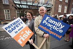 Repro Free: 24/09/2014 Dr Joie Fay and her father Dr Michael Fay are pictured as for the first time in the history of the state, GPs have been motivated to protest as patient safety is now at risk. GPs (as part of NAGP/ National Association of General Practitioners) outside Leinster House. Picture Andres Poveda