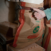 Old traditional flour mill, filling up bags with flour, PRN the Livradois-Forez, St. Dier d'Auvergne, Auvergne, France