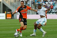 FOOTBALL - FRENCH CHAMPIONSHIP 2010/2011 - L1 - OLYMPIQUE DE MARSEILLE v FC LORIENT - 21/08/2010 - PHOTO PHILIPPE LAURENSON / DPPI - MORGAN AMALFITANO (LOR) / ANDRE AYEW (OM)