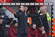 Arsenal manager Unai Emery has his arms out in the technical area during the Premier League match between Bournemouth and Arsenal at the Vitality Stadium, Bournemouth, England on 25 November 2018.