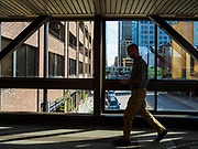 03 MAY 2017 - MINNEAPOLIS, MN:  People use a skyway in Minneapolis. The skyways are enclosed pedestrian overpasses that connect downtown buildings. The Minneapolis Skyway was started in the early 1960s as a response to covered shopping malls in the suburbs that were drawing shoppers out of the downtown area. The system grew sporadically until 1974, when the construction of the IDS Center and its center atrium, called the Crystal Court, served as a hub for the downtown skyway system. There are 8 miles of skyways, connecting most of the downtown buildings from Target Field (home of the Minnesota Twins) to US Bank Stadium (home of the Minnesota Vikings). In the last five years many upscale downtown apartment buildings and condominium developments have been added to the system, allowing downtown residents to live and work downtown without going outside.   PHOTO BY JACK KURTZ
