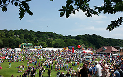 """© Licensed to London News Pictures. 13/07/2013<br /> <br /> Durham City, England, United Kingdom<br /> <br /> The racecourse is the traditional end of the parade where thousands of people socialise and enjoy the sunny weather during the Durham Miners Gala.<br /> <br /> The Durham Miners' Gala is a large annual gathering held each year in the city of Durham. It is associated with the coal mining heritage of the Durham Coalfield, which stretched throughout the traditional County of Durham, and also gives voice to miners' trade unionism. <br /> <br /> Locally called """"The Big Meeting"""" or """"Durham Big Meeting"""" it consists of banners, each typically accompanied by a brass band, which are marched to the old Racecourse, where political speeches are delivered. In the afternoon a Miners' service is held in Durham Cathedral <br /> <br /> Photo credit : Ian Forsyth/LNP"""