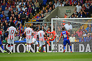 Crystal Palace defender James Tomkins (5) scores the opening goal during the Premier League match between Crystal Palace and Stoke City at Selhurst Park, London, England on 18 September 2016. Photo by Jon Bromley.
