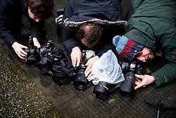 © Licensed to London News Pictures. 08/03/2017. London, UK. Photographers prepare remote controlled cameras on a rain soaked Downing Street before British chancellor Philip Hammond leaves 11 Downing Street in London to delivering his 2017 Budget to Parliament. Photo credit: Ben Cawthra/LNP