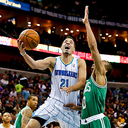 Mar 20, 2013; New Orleans, LA, USA; New Orleans Hornets point guard Greivis Vasquez (21) attempts a shot past Boston Celtics point guard Avery Bradley (0) during the first quarter of a game at the New Orleans Arena. Mandatory Credit: Derick E. Hingle-USA TODAY Sports