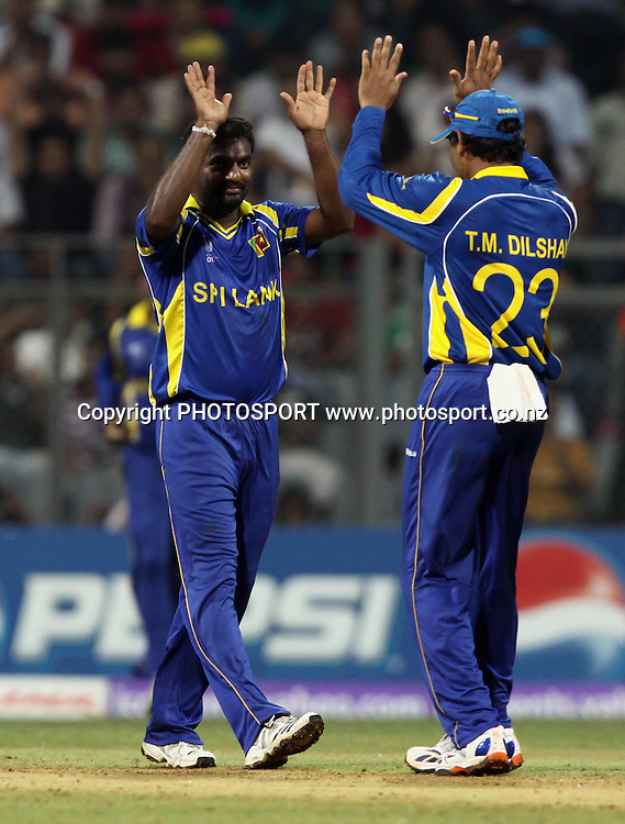 Sri Lankan bowler Muttiah Muralitharan celebrates with team mates New Zealand batsman Kane Williamson wicket During the ICC Cricket World Cup - 38th Match, Group A Sri Lanka vs New Zealand  Played at Wankhede Stadium, Mumbai (neutral venue) 18 March 2011 - day/night (50-over match)