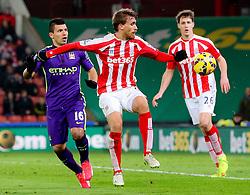 Stoke City's Marc Muniesa clears the ball - Photo mandatory by-line: Matt McNulty/JMP - Mobile: 07966 386802 - 11/02/2015 - SPORT - Football - Stoke - Britannia Stadium - Stoke City v Manchester City - Barclays Premier League