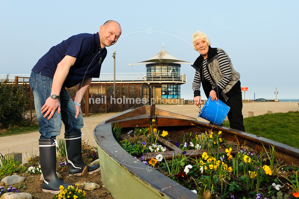 Hornsea Inshore Rescue, pictured Nev Metcalf (Coxswain and vice chairman of Hornsea Inshore Rescue) and Christine Sumner (Chairman of Hornsea in Bloom) tend the boat guardian at the inshore rescue boathouse.