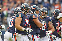 06 October 2013: Guard (75) Kyle Long of the Chicago Bears comes out the huddle with his teammates against the New Orleans Saints during the second half of the Saints 26-18 victory over the Bears in an NFL Game at Soldier Field in Chicago, IL.