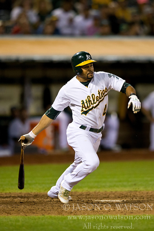 OAKLAND, CA - SEPTEMBER 23:  Coco Crisp #4 of the Oakland Athletics at bat against the Los Angeles Angels of Anaheim during the eighth inning at O.co Coliseum on September 23, 2014 in Oakland, California. The Los Angeles Angels of Anaheim defeated the Oakland Athletics 2-0.  (Photo by Jason O. Watson/Getty Images) *** Local Caption *** Coco Crisp