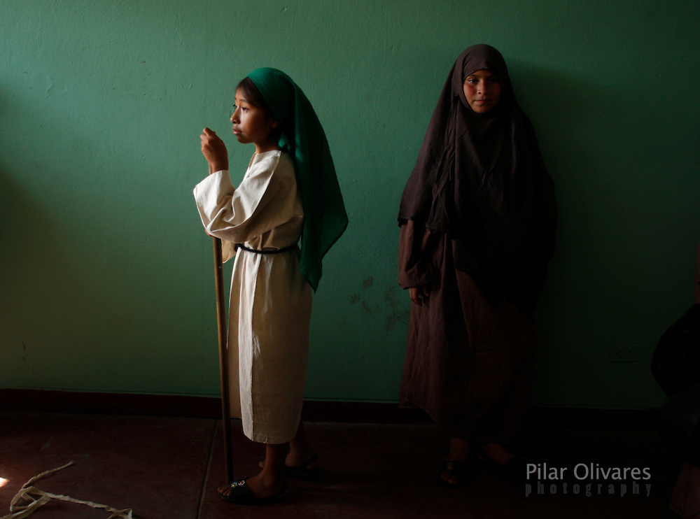 Girls wait to participate in the re-enactment of the crucifixion of Jesus Christ on Good Friday during Holy Week on the outskirts of Lima April 2, 2010.