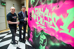 Pictured: Craig Robertson and Ken Macintosh<br /> Scottish Parliament Presiding Officer Ken Macintosh MSP today launched the 2017 Festival of Politics programme.  He was joined by street artist Craig Robertson as a 12ft-by-6ft work of art commissioned for this year's festival - which runs between October 19 and 21 - was unveiled<br />  <br /> Ger Harley | EEm 27 June  2017