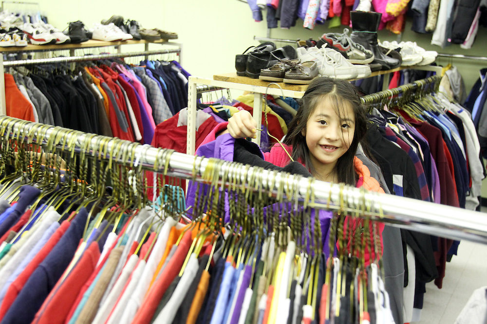 Galilea Muñiz looks through the racks. The Beaverton School District has a Clothes Closet for students in need. Photographed Wednesday, Jan. 25, 2011.