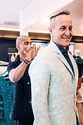 Bill Bensley trying on his bespoke silk jacket at Eric Raisina Couture House in Siem Reap