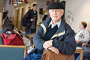 Roy Caple, a 79-year-old graduate student, poses on the first floor of Gordy Hall between classes on Tuesday, 11/14/06.
