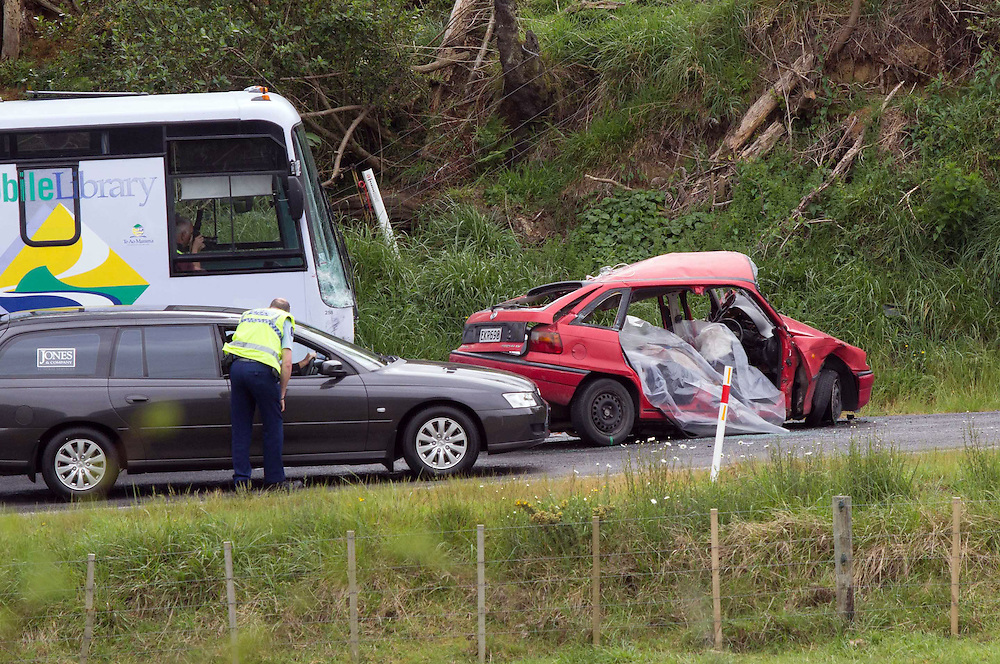 Police have closed Welcome Bay Road after one man died and another has been seriously injured following a mobile library bus and a car crashed near Faith Bible College, Tauranga, New Zealand, Wednesday, October 22, 2014.Credit:SNPA / Cameron Avery