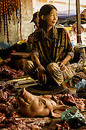 An old woman selling meat at local battambang market