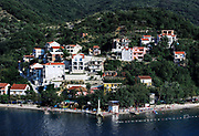 Beach and houses in village of Lepetane, Bay of Kotor, Montenegro