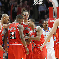 12 March 2012: Chicago Bulls point guard Derrick Rose (1) talks to his teammates Chicago Bulls forward Taj Gibson (22), Chicago Bulls guard Jimmy Butler (21), Chicago Bulls center Joakim Noah (13) during the Chicago Bulls 104-99 victory over the New York Knicks at the United Center, Chicago, Illinois, USA.