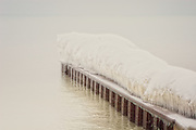 A caterpillar of ice lays on a pier. The Beaches waterfront, Toronto Canada.