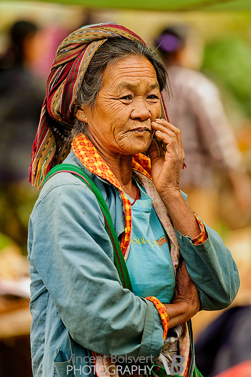 An elderly woman looking pensively in a local market, kalaw, Myanmar