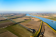 Nederland, Zuid-Holland, Hoeksche Waard, 07-02-2018; toerit en ingang tunnel van de HSL onder Dordtsche Kil. Hoeksche Waard. In de achtergrond spoorbruggen Hollandsch Diep.<br /> Entrance tunnel highspeed train, south of Rotterdam.<br /> <br /> luchtfoto (toeslag op standard tarieven);<br /> aerial photo (additional fee required);<br /> copyright foto/photo Siebe Swart