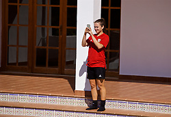 ALHAURÍN EL GRANDE, SPAIN - Tuesday, February 26, 2019: Wales' Megan Wynne cools off by the hotel swimming pool after a training session at the at Alhaurin Golf Resort in Spain. (Pic by David Rawcliffe/Propaganda)