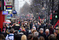 © Licensed to London News Pictures. 17/12/2016. London, UK. Seasonal shoppers take to the shops of Oxford Street in central London on December 17, 2016, on the last full weekend of shopping ahead of Christmas day.  Photo credit: Ben Cawthra/LNP