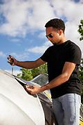 Bryan Harper - farmer, pilot - checking oil on his Harvard.