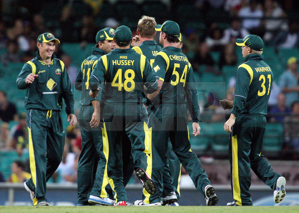 © Licensed to London News Pictures. 17/02/2012. Sydney Cricket Ground, Australia. The Australian team celebrate after getting Kumar Sangakkara out for 30 during the One Day International cricket match between Australia Vs Sri Lanka. Photo credit : Asanka Brendon Ratnayake/LNP