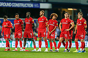 Bristol City players line up and watch on nervously during the penalty shoot-out, during the EFL Cup match between Queens Park Rangers and Bristol City at the Kiyan Prince Foundation Stadium, London, England on 13 August 2019.