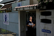 Lawyer Sor Rattanamanee Polkla in the doorway of the Community Resource Centre Foundation where she works. Her foundation assists communities around the country who face legal challenges often related to the environmental threats from companies.